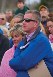 Grace's parents, Christopher and Lynn McDonnell, listen to the presentations during the ribbon cutting ceremony for the playground.